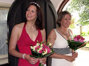 Two woman at wedding with flowers